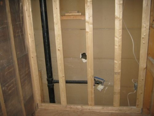 The right side of bathroom where sink and vanity will be located.