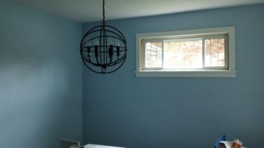 Light fixture in unpainted bedroom.