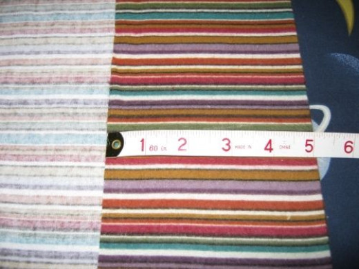 """Take one case and fold width wise 5"""" on one end. Use tape measure to measure all along edge. Press with steam iron (steam works best) to give a nice firm crease."""