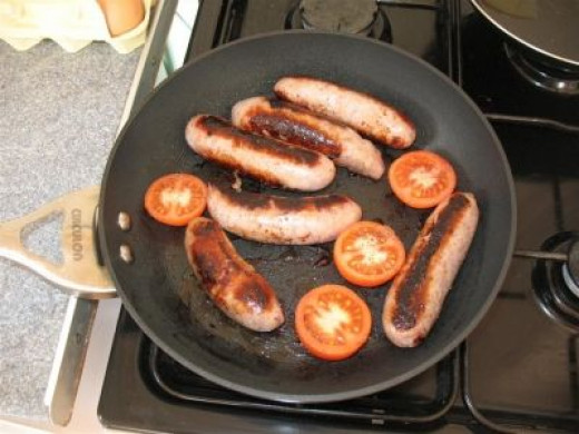 Begin with the items that take the longest to cook - Sausages, Bacon, Tomatoes