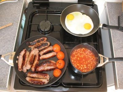 Next the quicker items - Baked Beans, Eggs etc. I like to slice my Sausages so the insides brown.