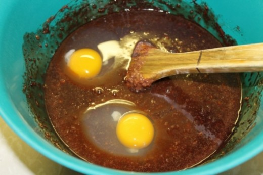 Add two eggs when oatmeal mixture cools. Stir with wooden spoon until blended.