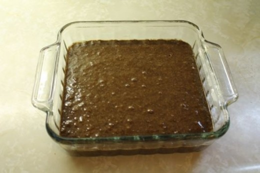 Pour into prepared baking dish and tap out bubbles. Bake for approximately 35 minutes at 350 F.