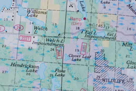 In this case, it tells us we are near the corner of sections 14 and 13 and sections 23 and 24, or very near Welch Lake.