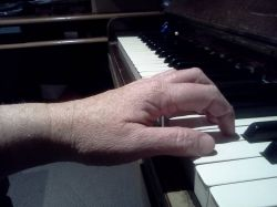 Curved Fingers and straight arm. Good for Piano Playing