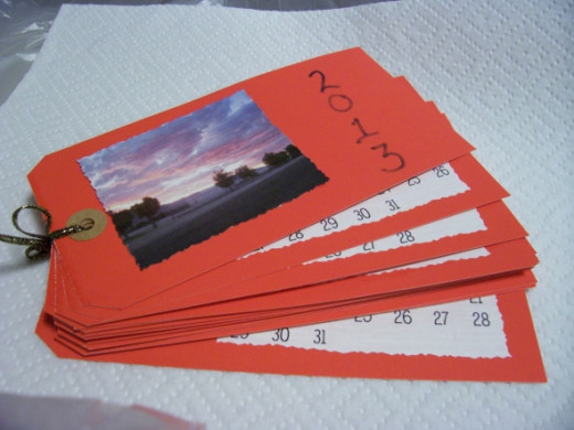 I had a couple of boxes of red tags, so I made calendars from them for gifts this year.