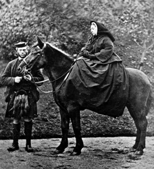 Queen Victoria on horseback. Seen with John Brown.
