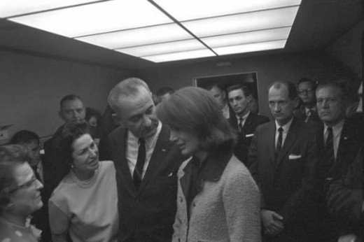 Lyndon B Johnson, the vice-president, is sworn into office aboard Air Force One in the presence of the newly-widowed Jackie Kennedy.