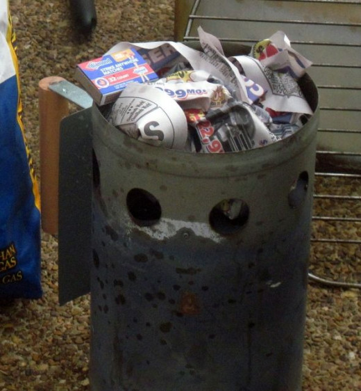 Stuff a sheet of newspaper in the bottom of your chimney grill starter