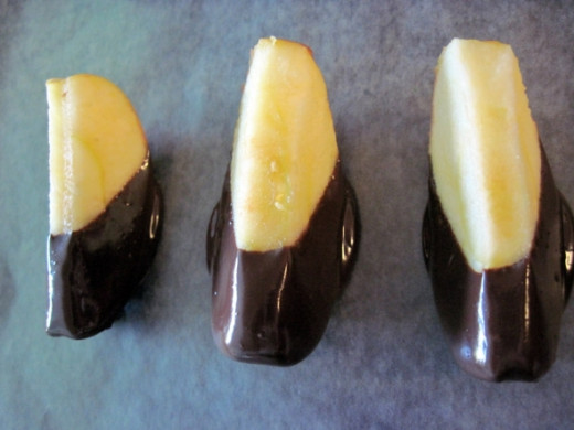 Place Chocolate Dipped Apple Slice on Wax Paper for Cooling