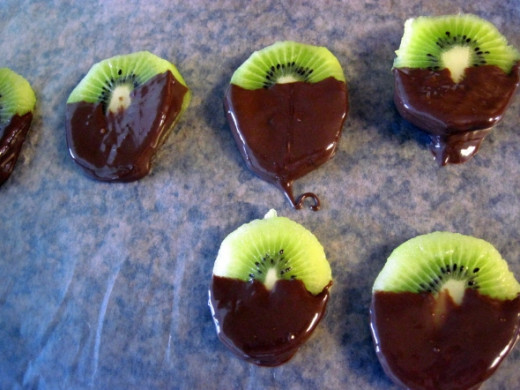 Place Chocolate Dipped Kiwi Slices on Wax Paper to Cool