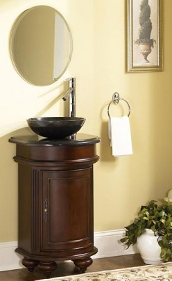 Dark-colored vanities in well-lit bathrooms really grab a guest's attention.