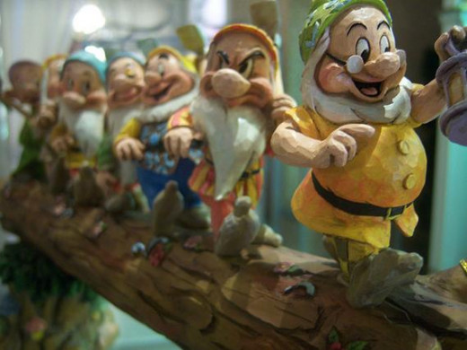 Jim Shore's Seven Dwarfs Walking Over Fallen Log Figurine