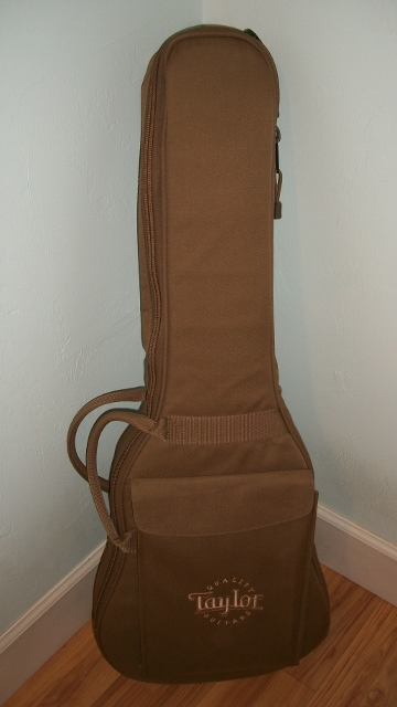 The gig bag is heavy canvas and has some padding and a storage pocket for storing picks and tuners and paper work.