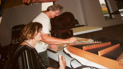 These ladies love to play the auto harp. Everyone takes a turn at it.