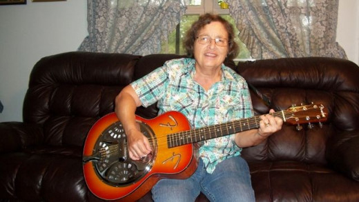Me with My Fender Resonator guitar. I really like to bring this guitar to class as it is really loud enough for everyone to hear. This is fun.