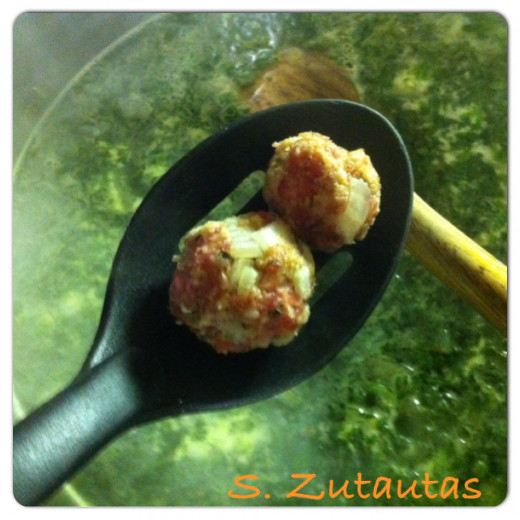 Next carefully on a slotted spoon add the meatballs