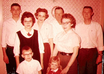 My wife with her parents and five siblings, early on.