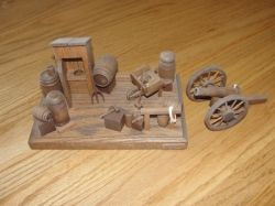 Outhouse and Cannon wood art