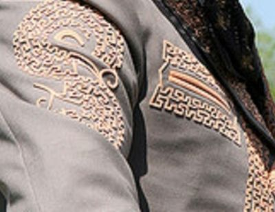 A close up of the intricate stitching on a mans jacket