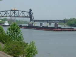 Barge hauling coal in Louisvill and Portland canal on Ohio River