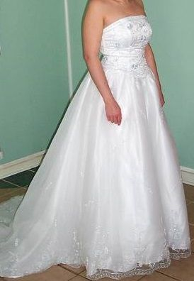 A-line dresses draw the eye upward and shrink the waistline