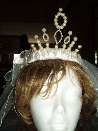 A tiara draws the eyes upward away from imperfections