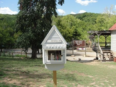 A cute little free library for guests. The mill building is to the right, the lodging is to the left. The river is directly ahead in this view