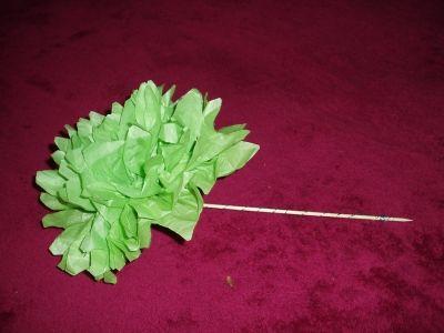 This flower can be wrapped with florist tape to give it a green stem if desired.