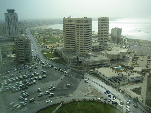 This is a view of some of the buildings in Tripoli along with some of the coastline of the natural harbour.  It is produced by StartAgain and distributed under Creative Commons Attribution-No Derivative Works 2.0 License.