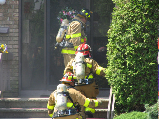 Making entry into a multi residential condo building with heavy fire showing.