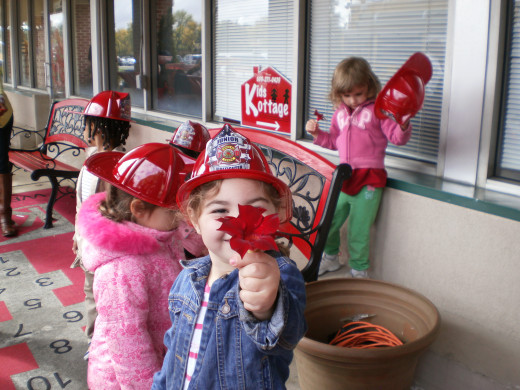 Firefighter pre-schoolers during Fire Prevention Week, my favorite red helmet firefighter of all.