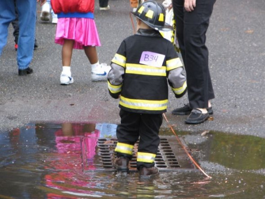 Firefighter kids always have a special place at the firehouse party and always seem to find some water to splash around in too (just like our firefighters LOL)