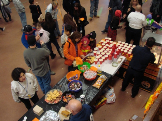 The main Halloween Party buffet is right here in the truck bay loaded with hot dogs and buns generously donated every year.