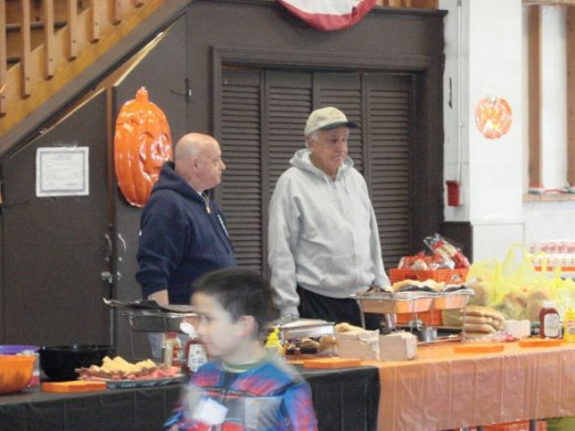 Halloween Party food is serious business and our volunteers are keeping the hot dogs warm and the cookies flowing