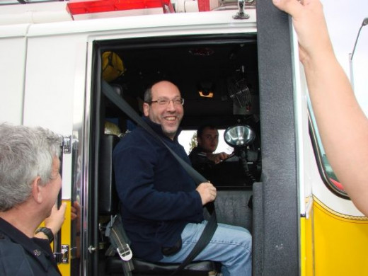 You don't have to be a kid to love a fire truck ride and East Windsor Councilman Marc Lippman gets to be the engine's officer on this ride out