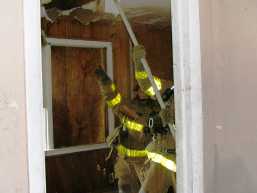 Overhaul after the fire is extinguished, checking for extension of fire beyond the walls, floors and ceilings.