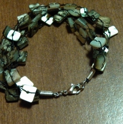 Here's the 4-strand black-lip shell bracelet I converted for my mom.