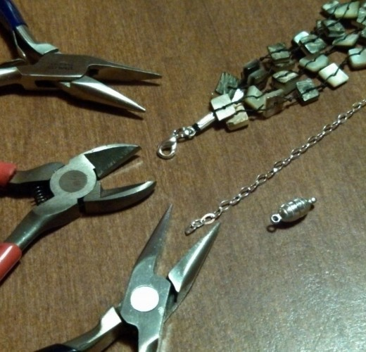 Tools you'll need - chain nose pliers, cutter, unfinished chain, magnetic clasp, and 2 split rings.