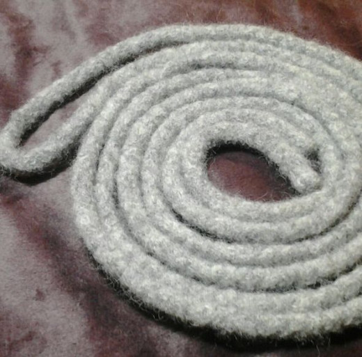 Felt the i-cord. Find videos for how to felt wool with or without a clothes dryer below.