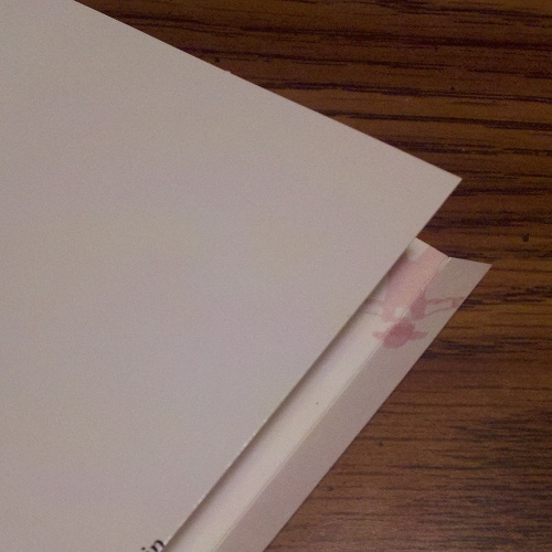 Cut a 1/4-inch strip off the back, and score the inside of the front cover along that line.