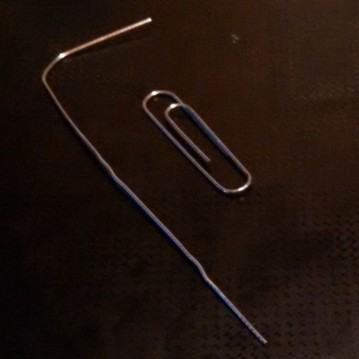 Now for the Paper Clip Trick. Straighten paper clips to hold your beads for painting and hands-free drying.