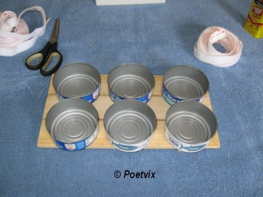 Arrange the cans so you get a good idea where you need to put the Velcro.