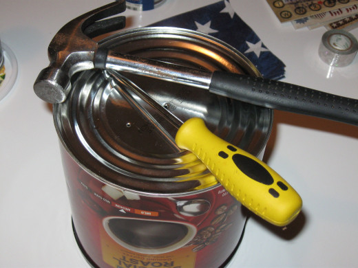Step two - make holes in the bottom of the cans.