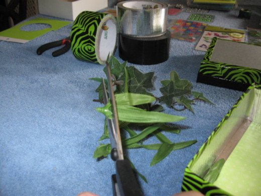 Make some grass by cutting off some skinny leaves from the artificial flowers.