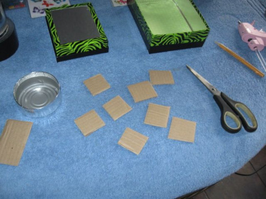 Cut some cardboard into squares.