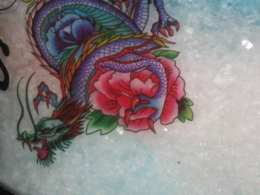 The Ed Hardy dragon temporary tattoo makes killer art on glass.
