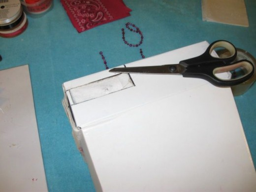 Be sure to cut and fold over the lining in the back where you cut a hole for the electrical cords.