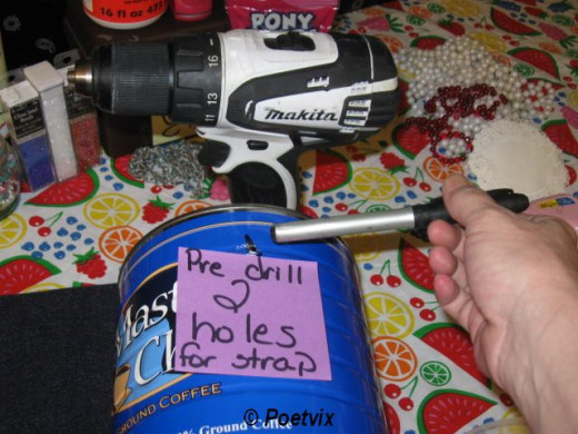 Step one is to drill a hole on each side of the can. Be careful. Since this is a circular shape, it's best to use a vice or maybe have someone hold the can if you are not experienced with a drill. This step should be done by parents for small childre