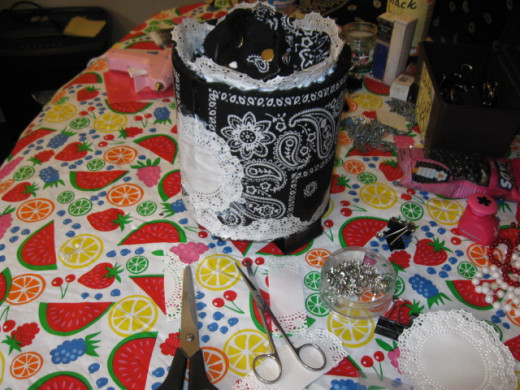 I added a solid doily to the outside. Cover the entire bag, every square inch save the bottom in Mod Podge, repeatedly.